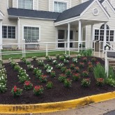 Mulch and seasonal flowers by Centennial Property Maintenance Centennial CO (303) 713-9306
